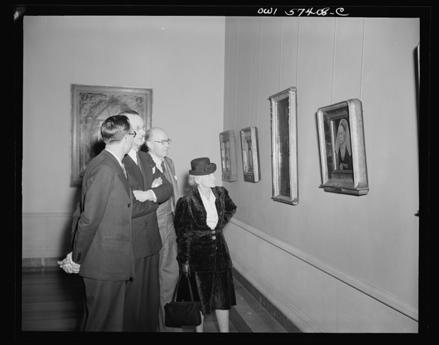 French journalists visit the National Gallery of Art, Washington, D.C., March 4, 1945. Left to right: Pierre Denoyer; Rene Batigne, Curator of the French Section at the Gallery who guided the guests on their tour; M. Jacques Rabut, Head of the French Construction Mission in Washington; and Mme. Andree Viollis