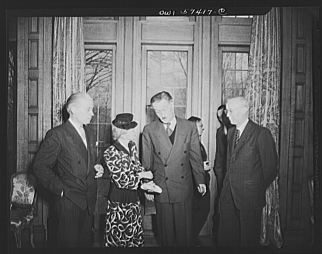 French journalists visiting the United States call on French Ambassador to the United States Henri Bonnet at the French Embassy where a luncheon was given for them March 6, 1945. Left to right: Francois Prieur, Mme Andree Viollis, Ambassador Bonnet and M. Louis Lombard