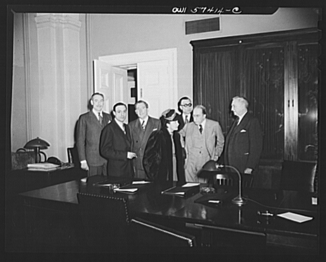 French journalists visiting the United States call on Senator George, Acting Chairman of the Foreign Relations Committee in the United States Senate. Individuals pictured include: Stephane Pizella, Mme. Etiennette Benichon, Pierre Denoyer, Senator Theodore Green, and Senator George
