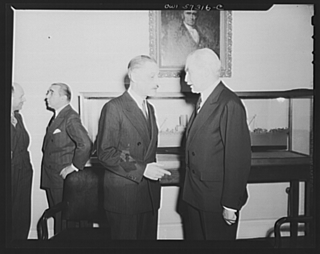 Henri Bonnet, French Ambassador, Joseph C. Grew, Undersecretary of State converse after signing French lend-lease and reverse lend-lease agreements