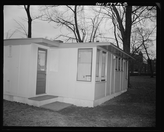 Houses for Britain. Kitchen entrance to model house erected by the Federal Public Housing Authority at Scott Circle, Washington, D.C. of the type which it is planned to ship to Great Britain under lend-lease. This prefabricated, temporary, emergency house was designed to use a minimum of critical materials including lumber