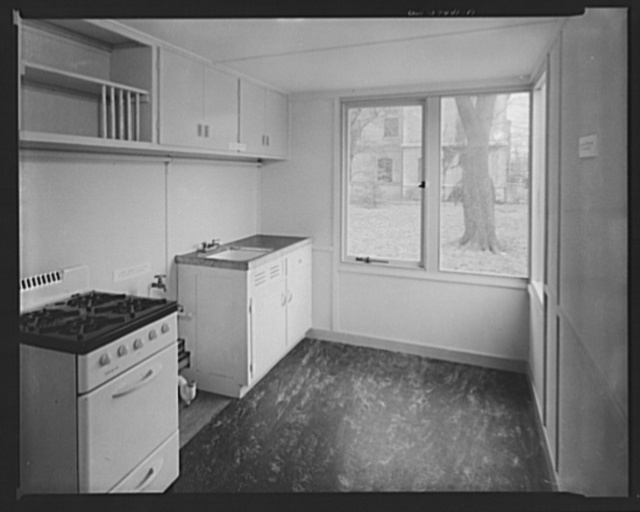 Houses for Britain. Kitchen of prefabricated model house erected by the Federal Public Housing Authority at Scott Circle, Washington, D.C. of the type of temporary, emergency dwelling which it is planned to ship to Great Britain under lend-lease. Doors of china cabinet and below sink to be omitted. Space left between stove and sink for laundry cabinet to be installed in England