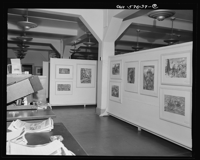 Installation of the United States Office of War Information (OWI) exhibit of original drawings and paintings by artists now in the armed forces. Preview, before shipping to Australia, held at the office of the Overseas Picture Division in the Auditor's Building
