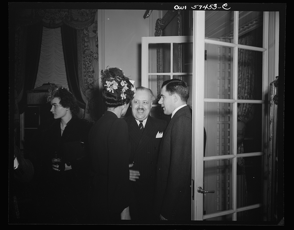 Madame Henri Bonnet, wife of French Ambassador, Ande Visson, French writer, and Andrei A. Gromyko, Ambassador from the Union of Soviet Socialist Republics at a reception celebrating International Women's Day at the home of Joseph E. Davies, former United States Ambassador to the Union of Soviet Socialist Republics