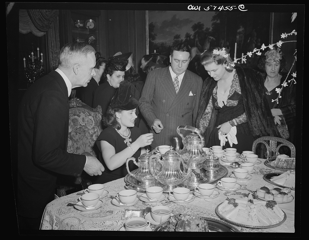 Mrs. A. Slionsaremko, wife of First Secretary of Russian Embassy, and Senator and Mrs. Brien McMahon at a reception celebrating International Women's Day at the home of Joseph E. Davies, former United States Ambassador to the Union of Soviet Socialist Republics