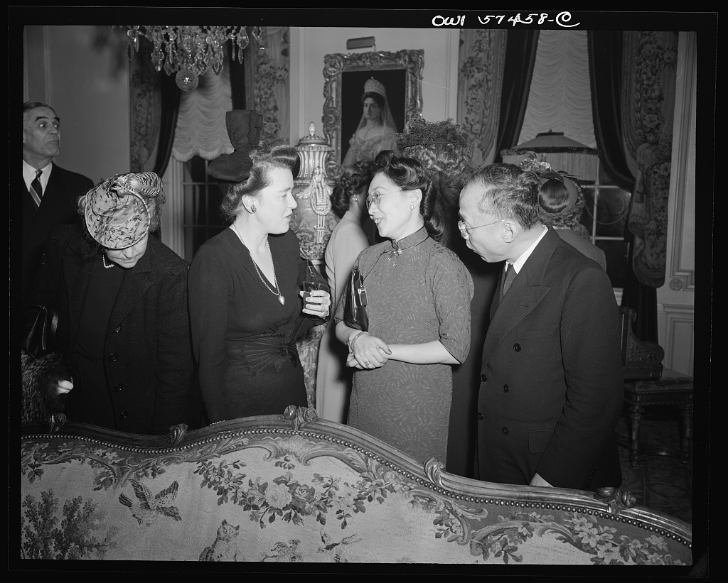 Mrs. James Clarke (wife of Office of War Information official and expert on the Balkans), Madame P.W.Kuo, Mr. Carson Chang at a reception celebrating International Women's Day at the home of Joseph E. Davies, former United States Ambassador to the Union of Soviet Socialist Republics
