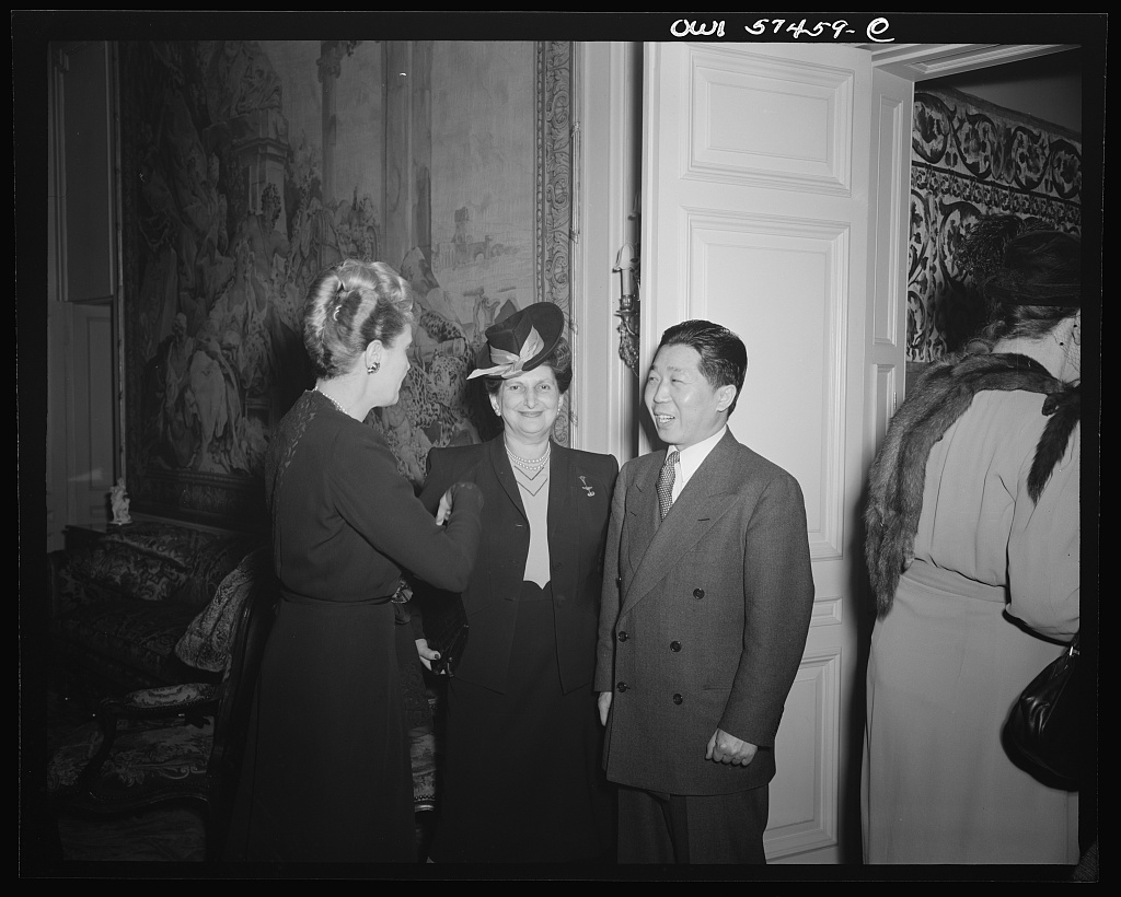 Mrs. Joseph Davies, Mrs Sidonie M. Gruenberg, Director, Child Study Association of America, Dr. Wei Tao-Ming, Chinese Ambassador at a reception celebrating International Women's Day at the home of Joseph E. Davies, former United States Ambassador to the Union of Soviet Socialist Republics