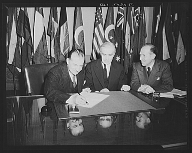 "Representatives of Turkey and Egypt sign the Declaration by United Nations. Joseph C. Grew, Undersecretary of State and Mahmond  Hassen, Minister of Egypt, watch as Orhan H. Eral, ""Charge d'Affaires ad interim of Turkey"" signs the declaration"