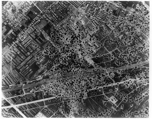 The Marifu railyard, 2 miles east of Iwakuni, and 2 miles south of Otaka, Japan, after the bombing raid of 14 August 1945 by B-29 Superforts of the 21st Bomber Command
