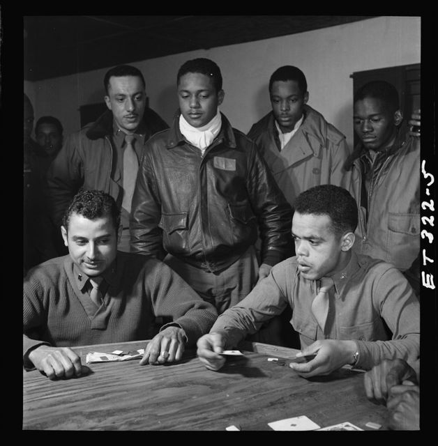[Tuskegee airmen playing cards in the officers' club in the evening]