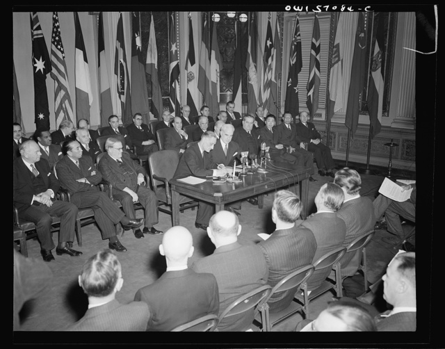 Washington, D.C. Henri Bonnet, French Ambassador, signing the United Nations declaration at the State Department