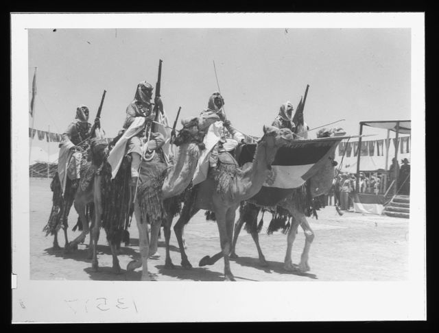 "'Coronation' of King Abdullah in Amman. Colour party ""Lowering the Colors"" when passing saluting base before the king. Corps Elite"