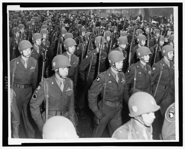 [Members of the 82nd Airborne Division marching in a parade in New York City] / World Telegram & Sun photo by Al Aumuller.