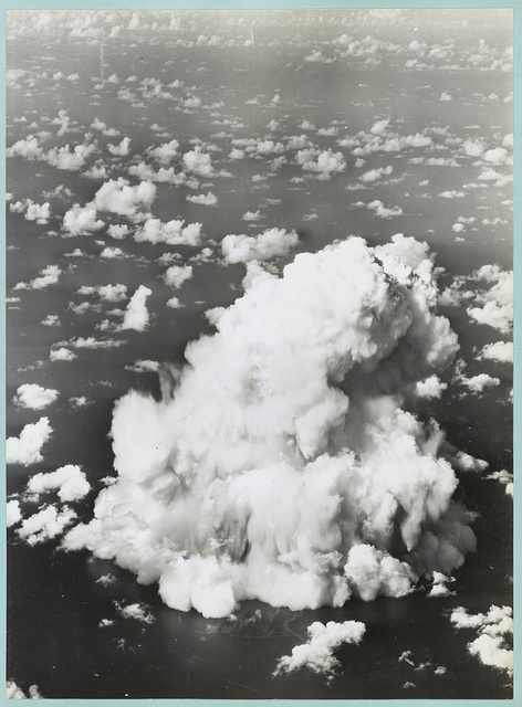 [Mushroom cloud with ships below during Operation Crossroads nuclear weapons test on Bikini Atoll]