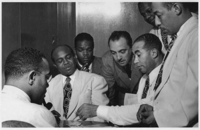 [Portrait of Al Sears, Shelton Hemphill, Junior Raglin, Django Reinhardt, Lawrence Brown, Harry Carney, and Johnny Hodges, Aquarium, New York, N.Y., ca. Nov. 1946]