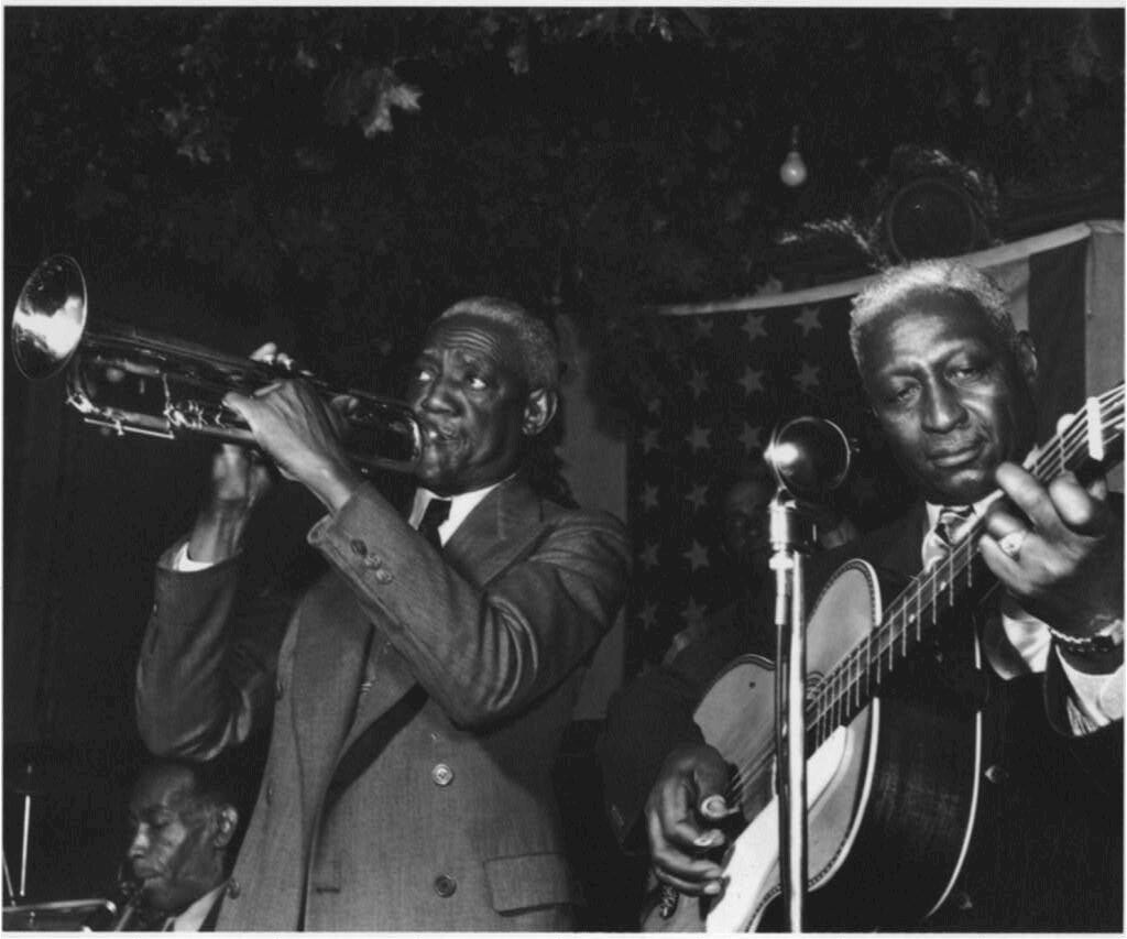 [Portrait of Bunk Johnson, Leadbelly, George Lewis, and Alcide Pavageau, Stuyvesant Casino, New York, N.Y., ca. June 1946]