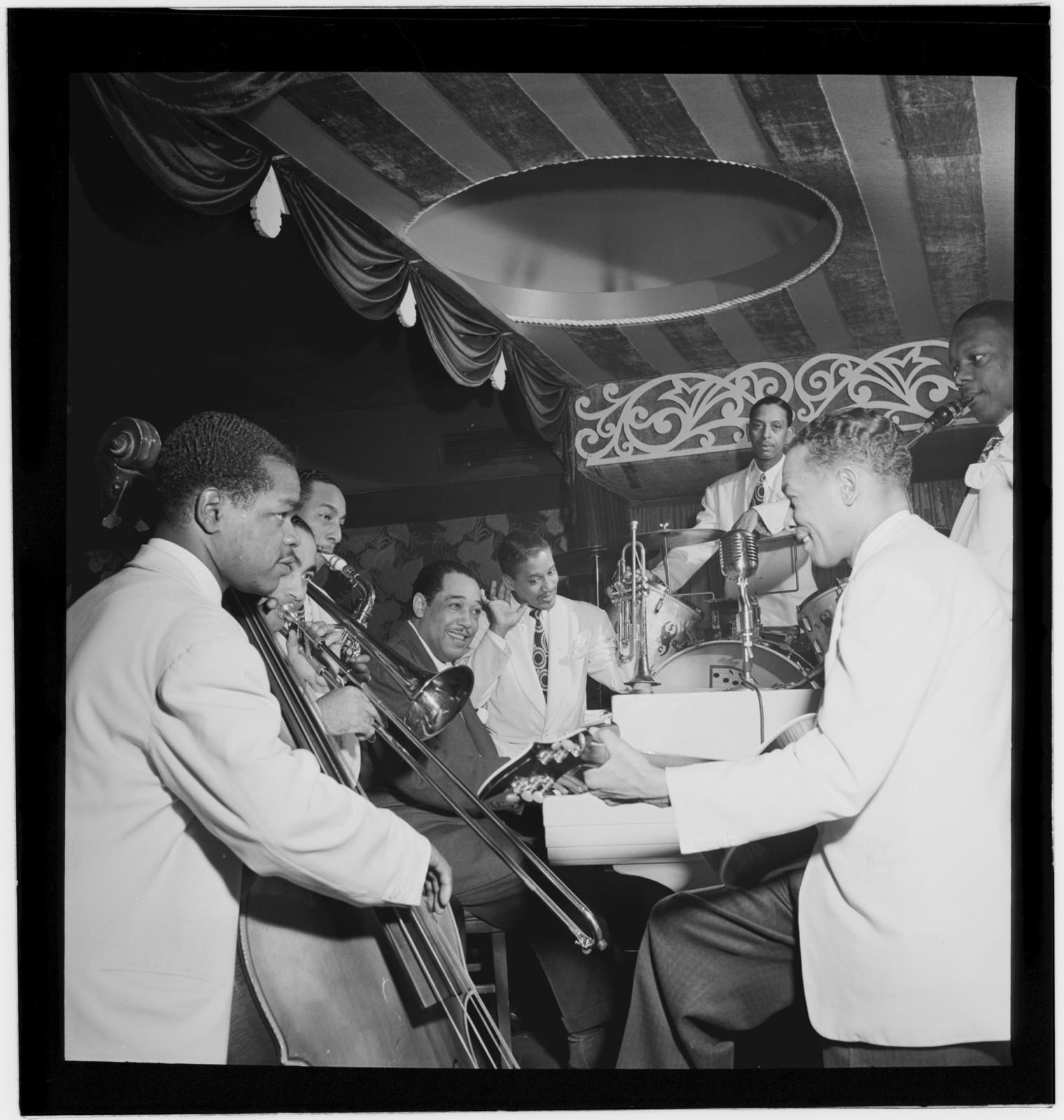 [Portrait of Junior Raglin, Lawrence Brown, Johnny Hodges, Duke Ellington, Ray Nance, Sonny Greer, Fred Guy, and Harry Carney, Aquarium, New York, N.Y., ca. Nov. 1946]