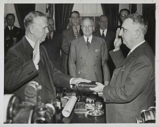 Marshall becomes Secretary of State Gen. George C. Marshall (left) re-enacts oath-taking ceremony in which he became Secretary of State in the office of President Truman in Washington, D.C., Jan 21.
