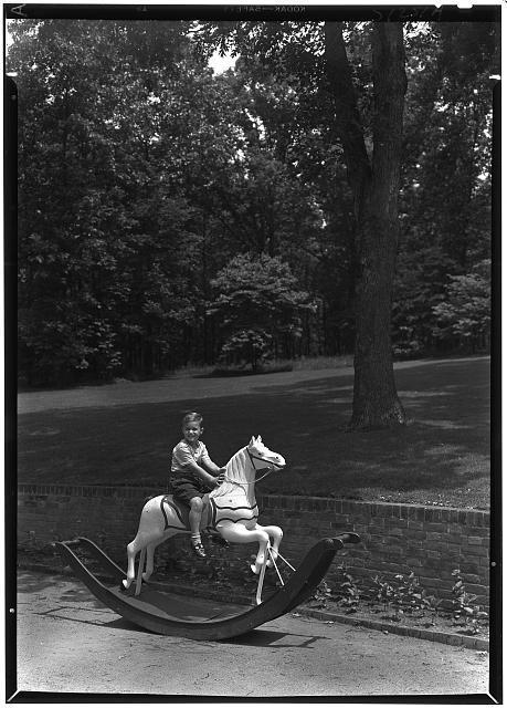 Paul Mellon, residence in Upperville, Virginia. Timmie on hobbyhorse