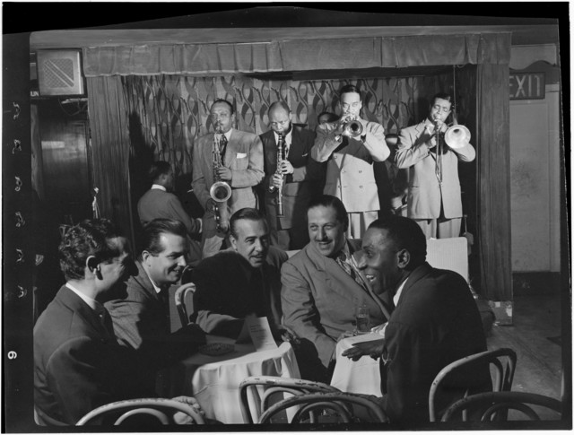[Portrait of Ben Webster, Eddie (Emmanuel) Barefield, Buck Clayton, Benny Morton, Joe Marsala, and Cozy Cole, Famous Door, New York, N.Y., ca. Oct. 1947]