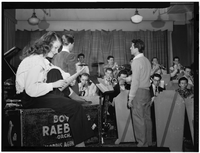 [Portrait of Boyd Raeburn, Ginnie Powell, vocalist Johnson, Irv Kluger, Pete Candoli, Wes Hensel, Gordon Boswell, Hy Mandell, Randy Bellerjeau, Abe Markowitz, and Buddy De Franco, Nola's, New York, N.Y., ca. Feb. 1947]