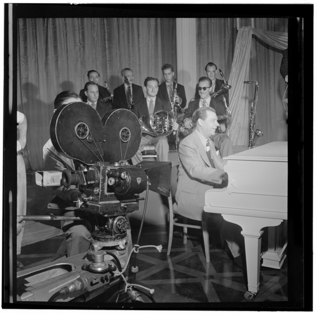 [Portrait of Claude Thornhill, Sandy Siegelstien, Willie Wechsler, Micky Folus, Mario Rullo, Danny Polo, Lee Konitz, Bill Bushing, and Joe Shulman, Columbia Pictures studio, the making of Beautiful Doll, New York, N.Y., ca. Sept. 1947]