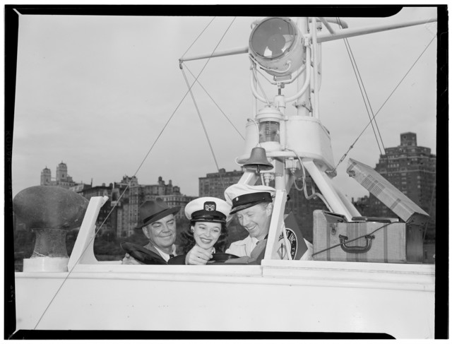 [Portrait of Cliff Edwards, Betty Brewer, and Frank Raye, Ukelele Lady (yacht), Hudson River, N.Y., ca. June 1947]