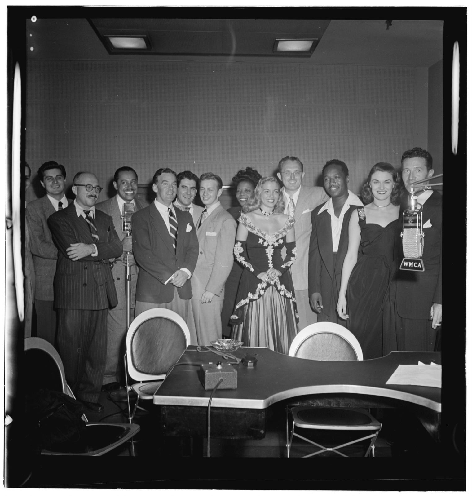 [Portrait of Johnny Desmond, Martin Block, Cab Calloway, Georgie Auld, Mel Tormé, Mary Lou Williams, Tommy Dorsey, Josh White, Beryl Davis, and Ray McKinley, WMCA, New York, N.Y., ca. Oct. 1947]