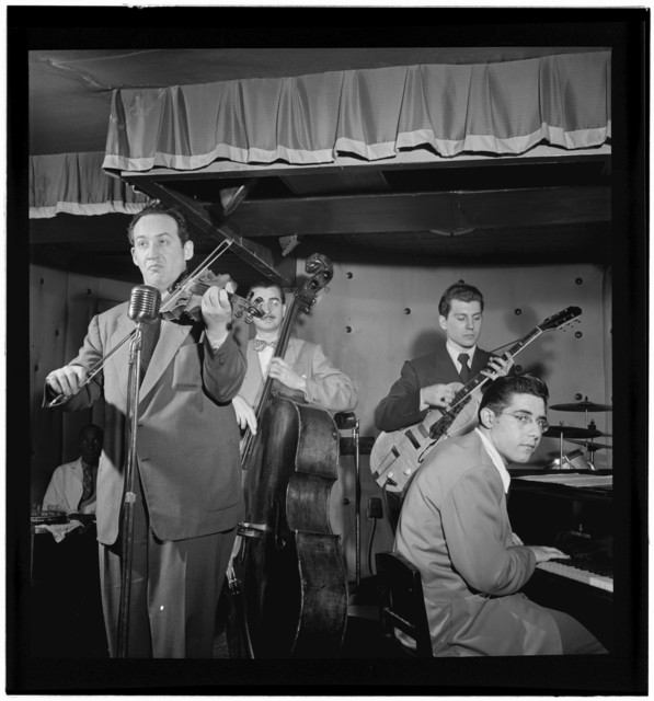 [Portrait of Sam Hall Kaplan, Frenchy Cauette, Chuck Wayne, and Deryk Sampson, Three Deuces, New York, N.Y., ca. June 1947]