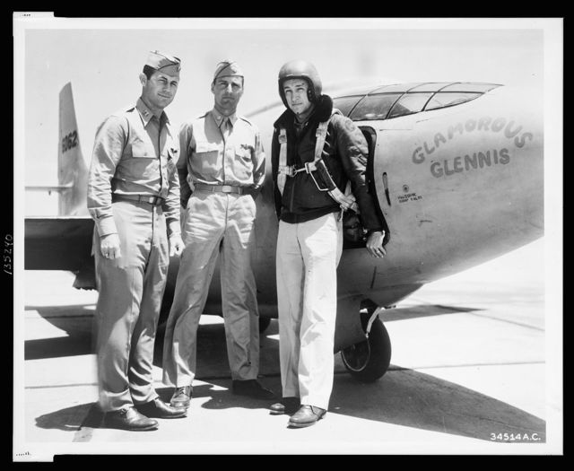 Standing left to right alongside of Bell XS-1 are: Captain Charles E. Yeager, Major Gus Lundquist and Captain James Fitzgerald