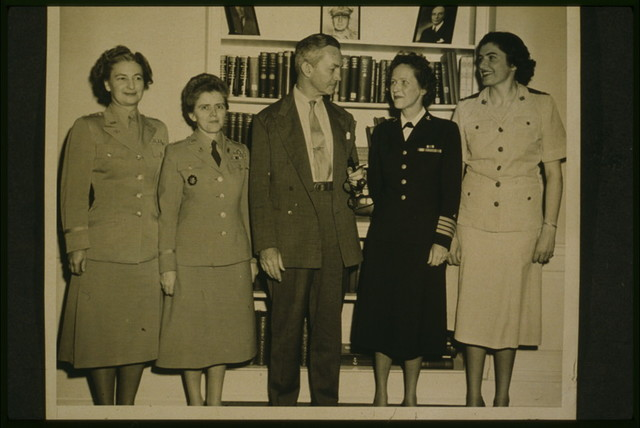 [Secretary of Defense James Forrestal (center) congratulates (l to r) Colonel Geraldine May, Colonel Mary A. Hallaren, Captain Joy Bright Hancock, and Major Julia E. Hamblet, after the passage of the Women's Armed Services Integration Act, the Pentagon, Washington, D.C.] / U.S. Army Signal Corps photograph.