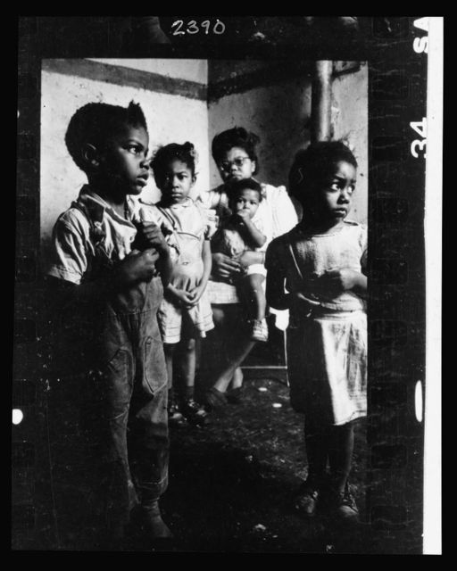 [African American mother and her four children in their tenement appartment] / Stanley Kubrick.