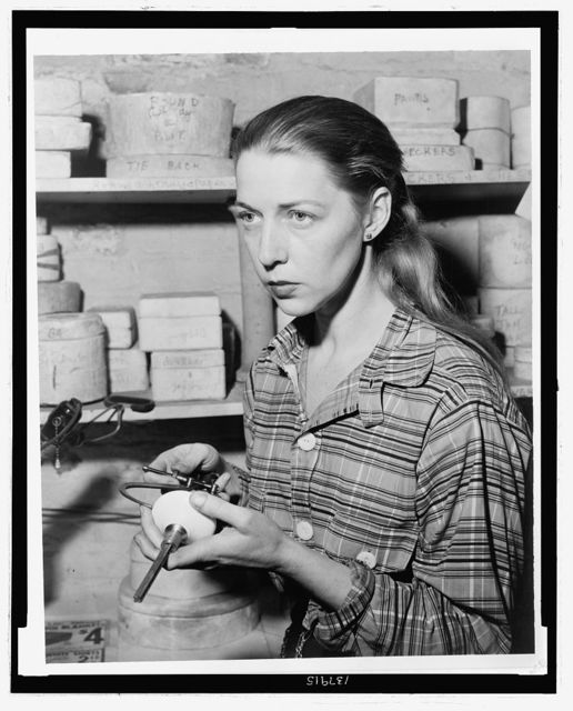 Carol Janeway, ceramist with door knobs / World Telegram & Sun photograph by Al Aumuller.