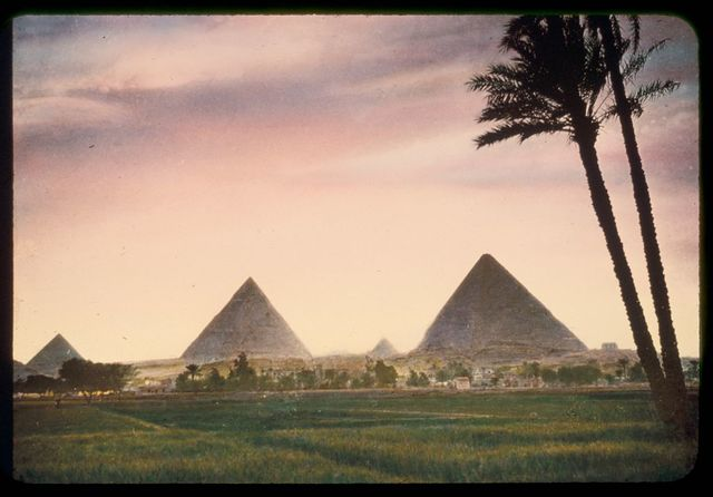 Egypt. Pyramids. Pyramids silhouetted against strong evening glow