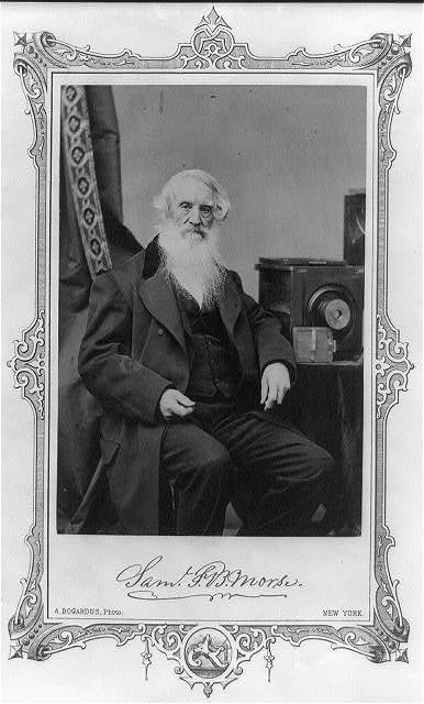 [Samuel F.B. Morse, three-quarter-length portrait, seated, facing front, posed with a camera and glass plate negatives]