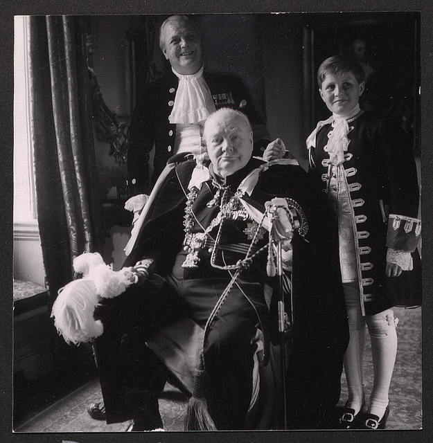 Sir Winston, his son Randolf [i.e., Randolph], and grandson, Winston in coronation robes