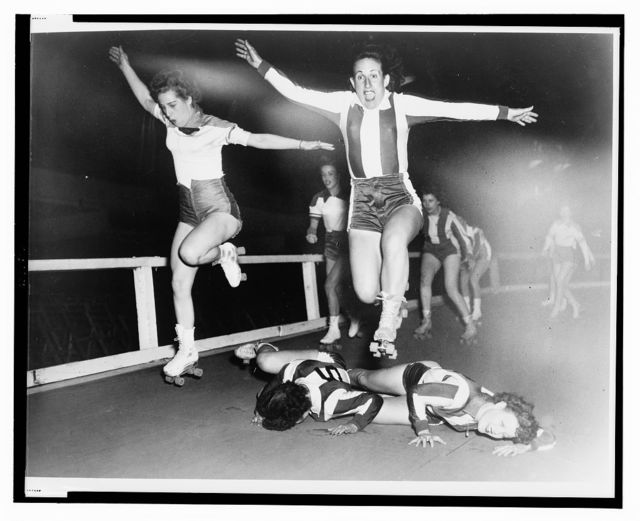 [Two women's league roller derby skaters leap over two who have fallen] / World-Telegram photo by Al Aumuller.