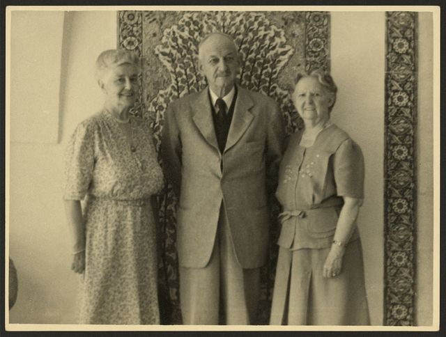 [John Whiting, three-quarter length portrait, standing, facing front, with Bertha Vester (left) and his wife, Grace Whiting (right)]
