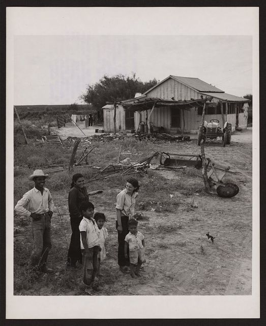 [Manuel Ramiriz and members of his family in front of their home in Texas will be relocated as a result of the joint U.S.-Mexico Falcon Dam construction project on the Rio Grande River]