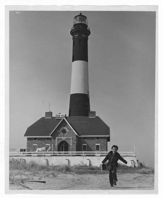 Richard Mahler (5) is the Fire Island School's youngest pupil and lives the farthest away. His father is the lighthouse keeper and, since the lighthouse is about four miles away, school is a long ride by jeep / World Telegram & Sun photo by Roger Higgins.