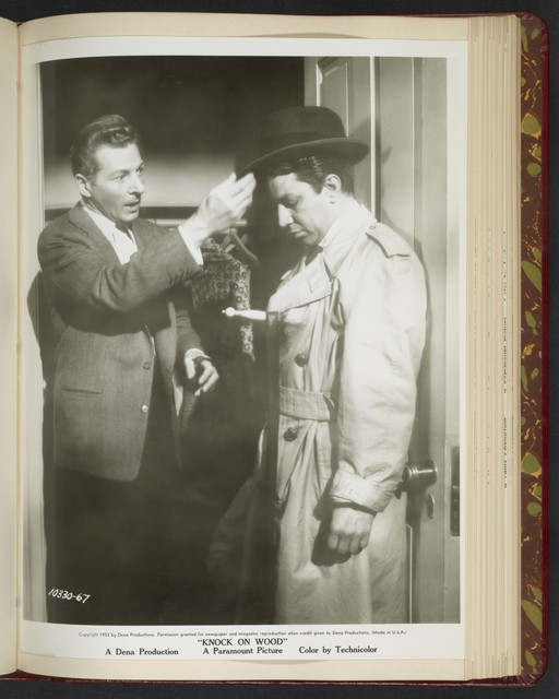 "[ Danny Kaye adjusting the hat of male character - scene from ""Knock on Wood""]"