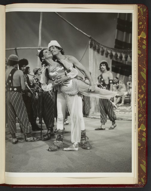 "[ Danny Kaye dances onstage with female character in exotic costume - scene from ""Knock on Wood""]"