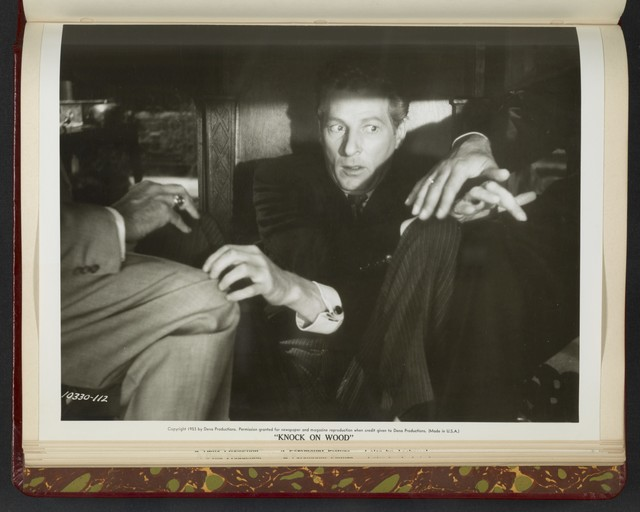 "[ Danny Kaye hiding under table - scene from ""Knock on Wood""]"