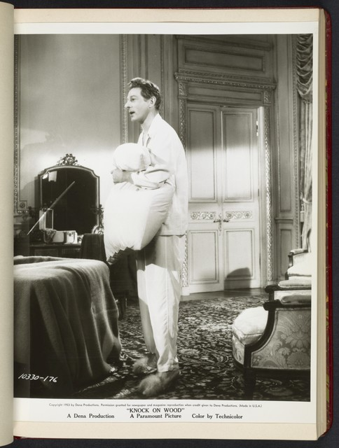 "[ Danny Kaye holding pillow in hotel room - scene from ""Knock on Wood""]"