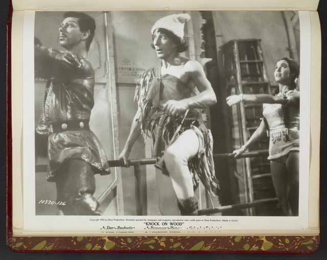 "[ Danny Kaye in costume onstage dancing with characters - scene from ""Knock on Wood""]"