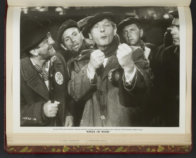 "[ Danny Kaye mock-fighting surrounded by men - scene from ""Knock on Wood""]"
