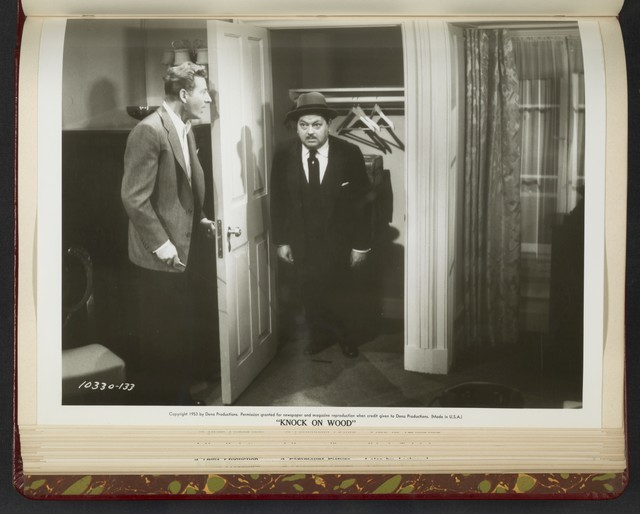 "[ Danny Kaye opens closet door revealing Leon Askin - scene from ""Knock on Wood""]"