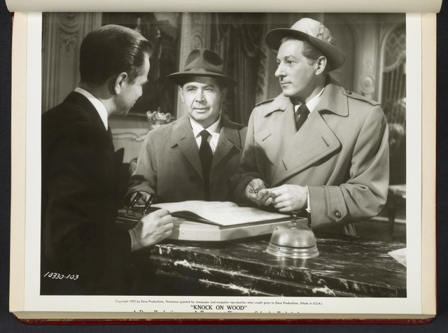 "[ Danny Kaye with men in hotel lobby - scene from ""Knock on Wood""]"