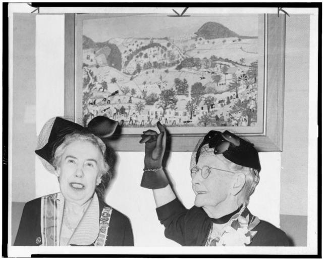 """[Grandma Moses donating her painting """"Battle of Bennington"""" to Mrs. George Kuhner who accepts it for DAR] / World-Telegram photo by Roger Higgins."""