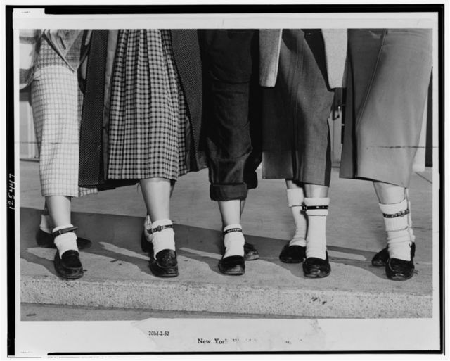 [Legs and feet of five teenage girls wearing dog collar anklets on their socks] / World-Telegram photo by Roger Higgins.